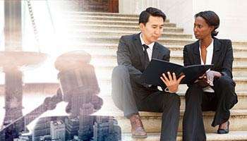 montage of a judge's gavel and a city superimposed on top of a photo of a male and female attorney discussing a case while sitting on the steps of a courthouse