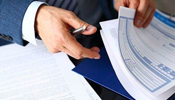 close up photo of insurance policy papers that someone is perusing