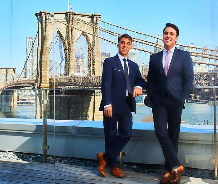 March 11, 2019: Procor Founders Arnie Mascali and Frank Russo stand in front of the Brooklyn Bridge.